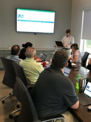 Kris Brady training Historymaker Homes on informXL Analyzers